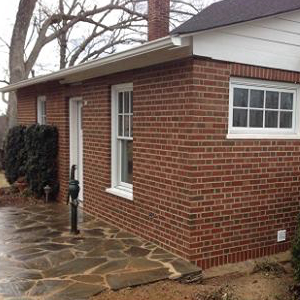 Residential brick masonry sidewalk and stoop